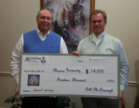 Photo of Joe Greenlee presenting a check to Marion University