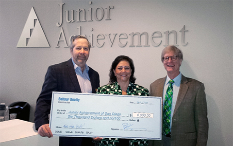 Marla Black (center), President & CEO at Junior Achievement of San Diego County, accepts an initial $6,000 gift from Brian Cahill (left), President of Balfour Beatty Construction's California Division and Barry Menzel (right), Managing Director of Training Funding Source (TFS). The donation represents a partnership of shared savings between Balfour Beatty Construction, JA San Diego, TFS and Accretive of San Diego and is projected to reach $28,000 in the next year.